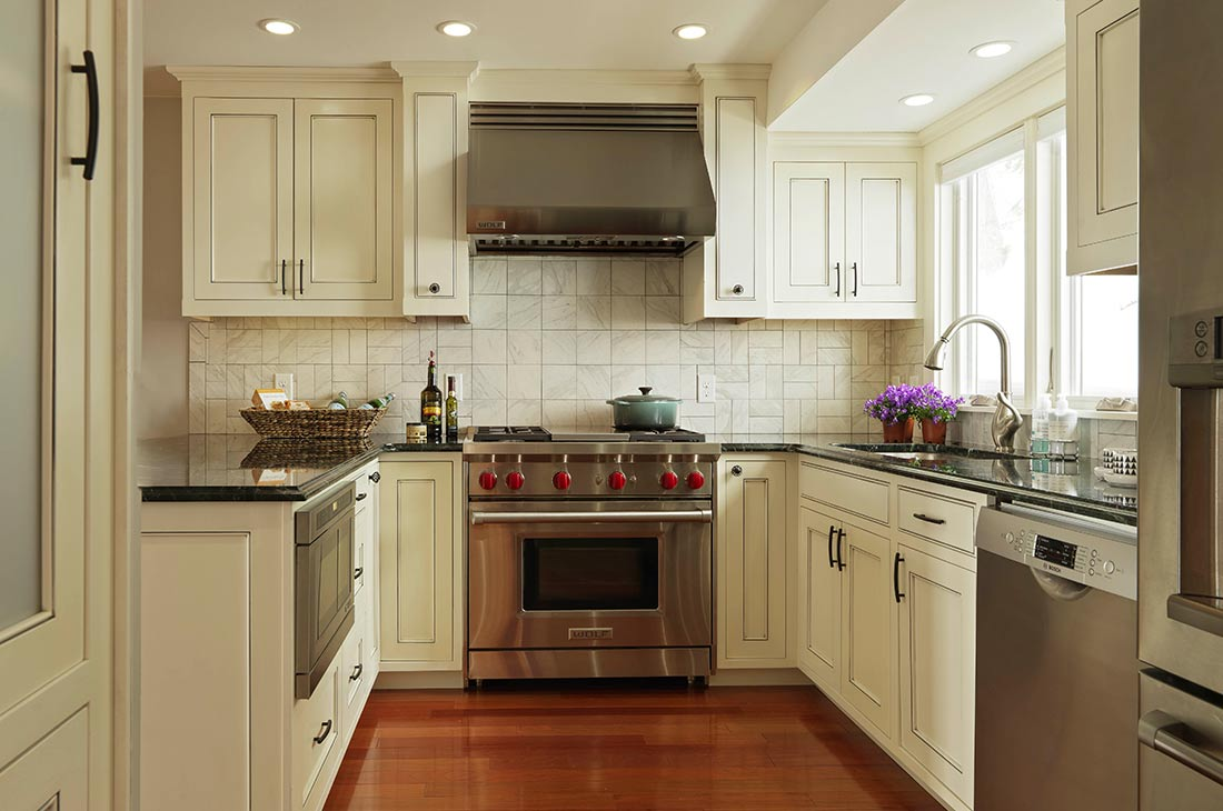 white country style kitchen with gas range