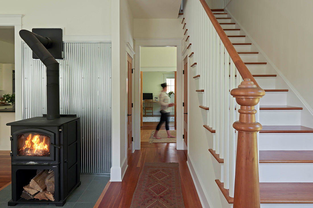 picture of staircase and small woodstove