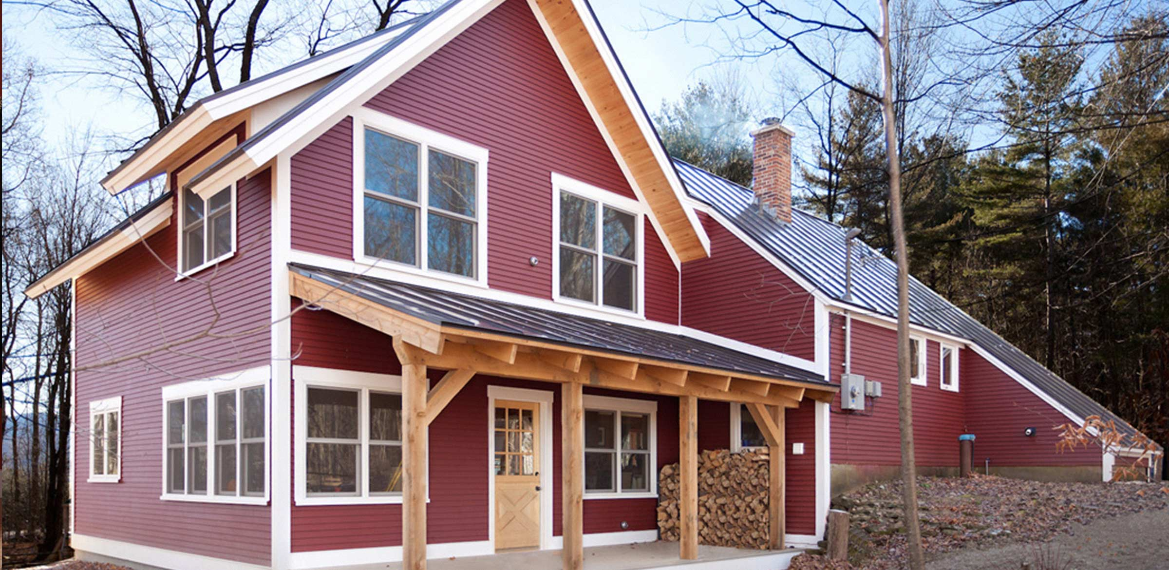 a red home with timber deck