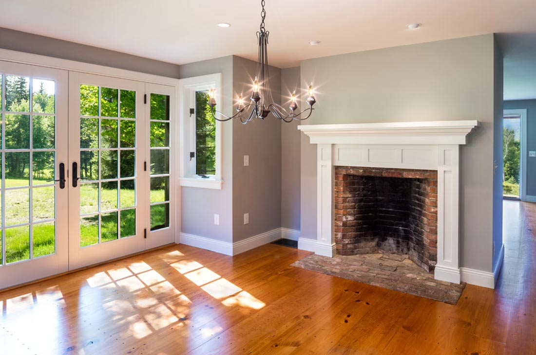 room with fireplace and french doors