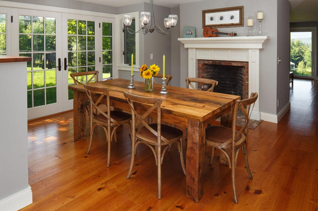 dining room with fireplace and wooden dining set