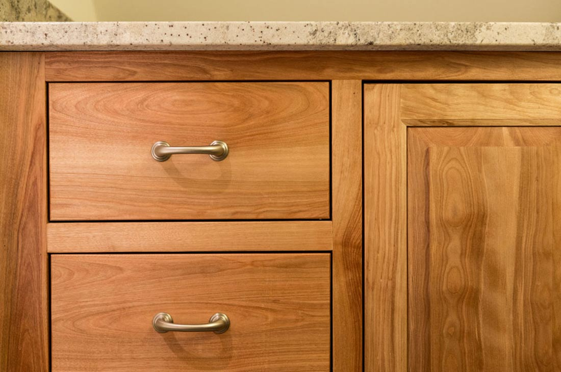 granite countertops and wooden cabinets
