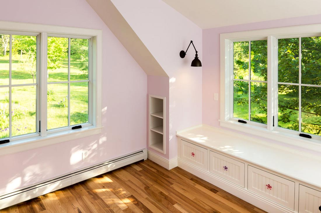 pink bedroom with built in bench seat