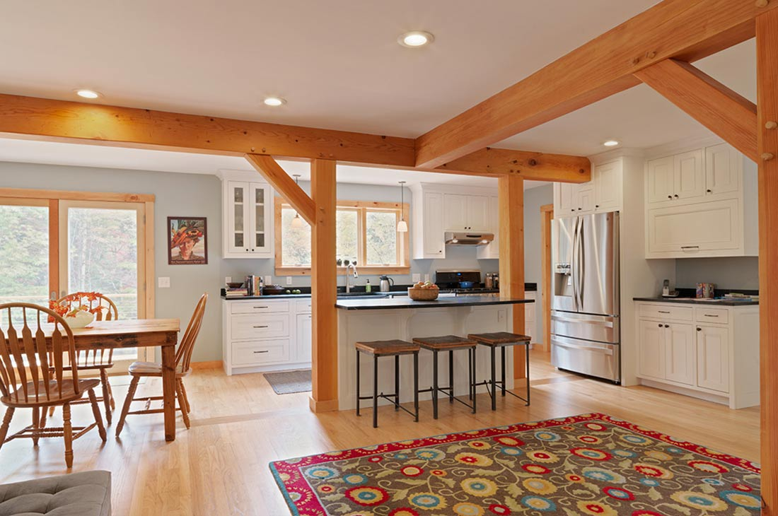 picture of the kitchen with timber frame and dining area